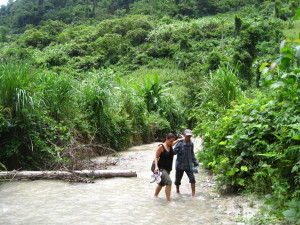 Wan helping Vanessa cross one of the 25 rivers barefoot