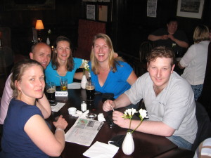 Rachel, Tom and their friends at a British trivia night