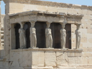The Caryatids (four statues of women that are holding it )